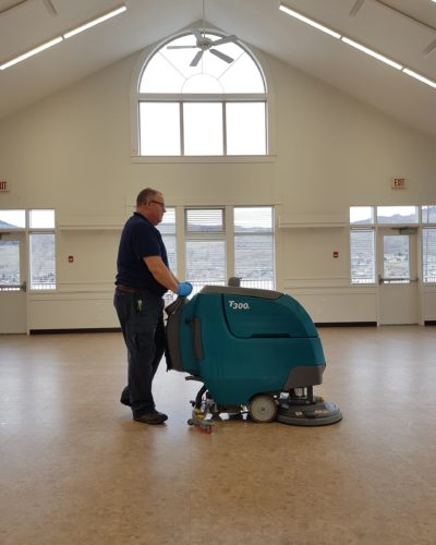 Bill Tarr prepping floors for refinishing with T300 autoscrubber